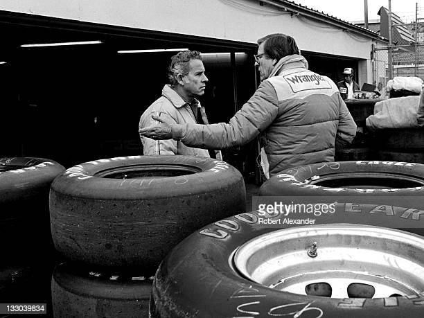 NASCAR driver David Pearson left talks with Bud Moore owner of the Wrangler Jeans car driven by Dale Earnhardt Sr in the Daytona International...
