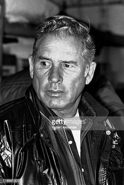 NASCAR driver David Pearson pauses in the Daytona International Speedway garage prior to the start of the 1983 Daytona 500 on February 20 1983 in...