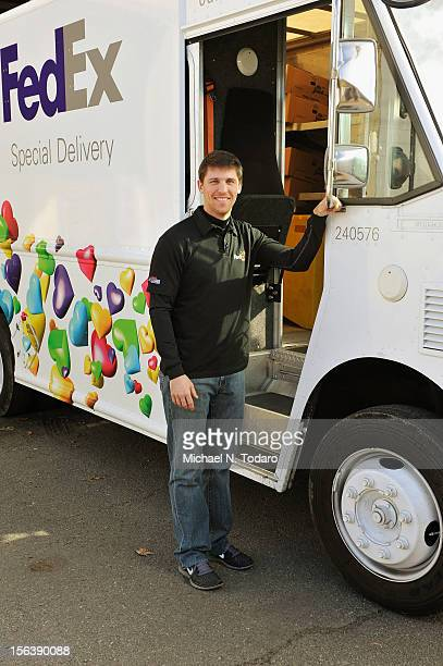 Driver Denny Hamlin and FedEx crew members join NJbased FedEx volunteers to deliver donated meals at The Community FoodBank of New Jersey on November...