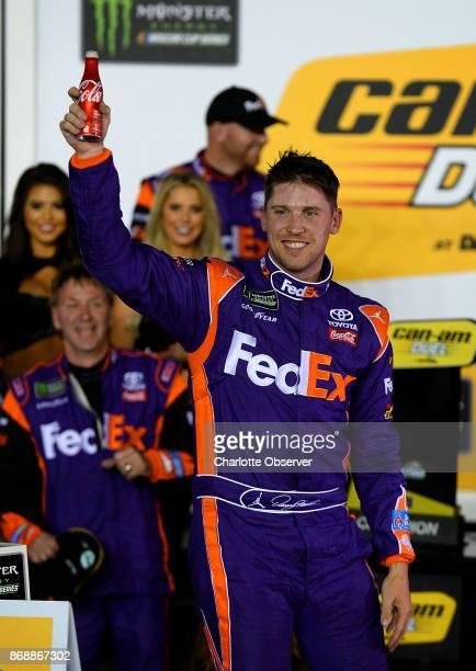 NASCAR driver Denny Hamlin celebrates winning the second CanAm Duel race at Daytona International Speedway in Daytona Beach Fla on February 23 2017