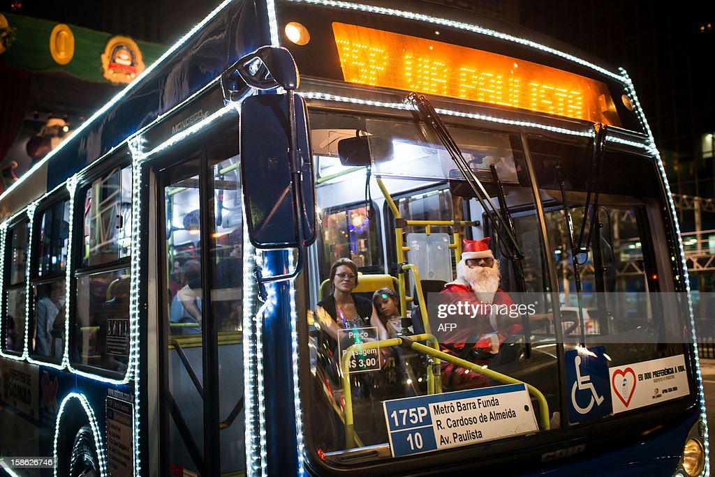A driver disguised as Santa Claus drives a public bus at Paulista Avenue in Sao Paulo, Brazil, on December 21, 2012. Paulista avenue will host New Year's eve event and about 2 million people are expected for music shows and fireworks.