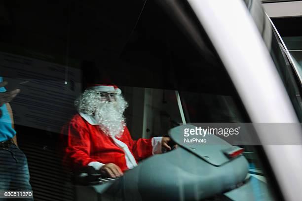 A driver disguised as Santa Claus drives a public bus in Rio de Janerio Brazil December 24 2016 Santa Claus driving a train from VLT Carioca Light...