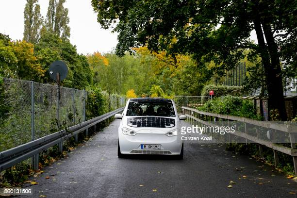 A driver drives a Sono Motors Sion solarpowered electric car during a presentation event on October 11 2017 in Berlin Germany Munichbased Sono Motors...