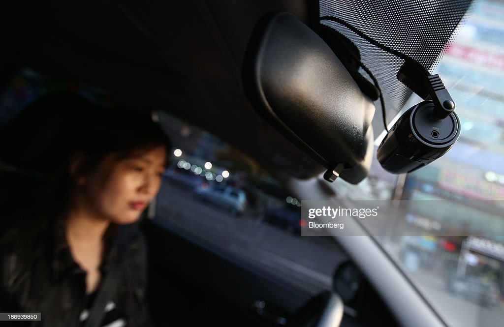 A driver drives as a JaewonCnc IRoad black box camera operates inside a vehicle in Incheon, South Korea, on Monday, Nov. 4, 2013. Black boxes for cars are devices that automatically record video and audio as well as time, location and speed. Photographer: SeongJoon Cho/Bloomberg via Getty Images