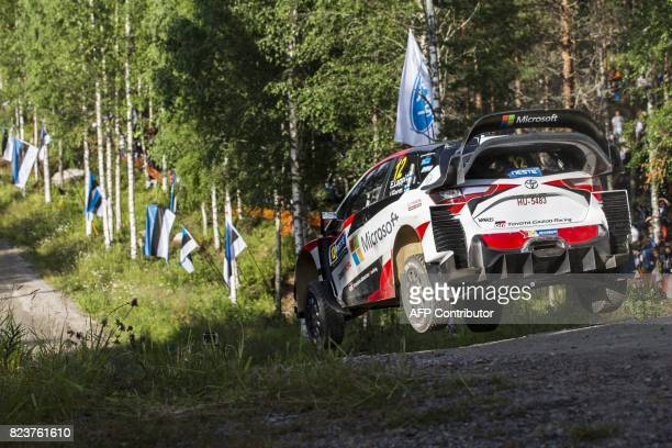 Driver Esapekka Lappi of Finland and his codriver Janne Ferm of Finland steer their Toyota Yaris WRC during the 3rd stage Urria of the Neste Rally...