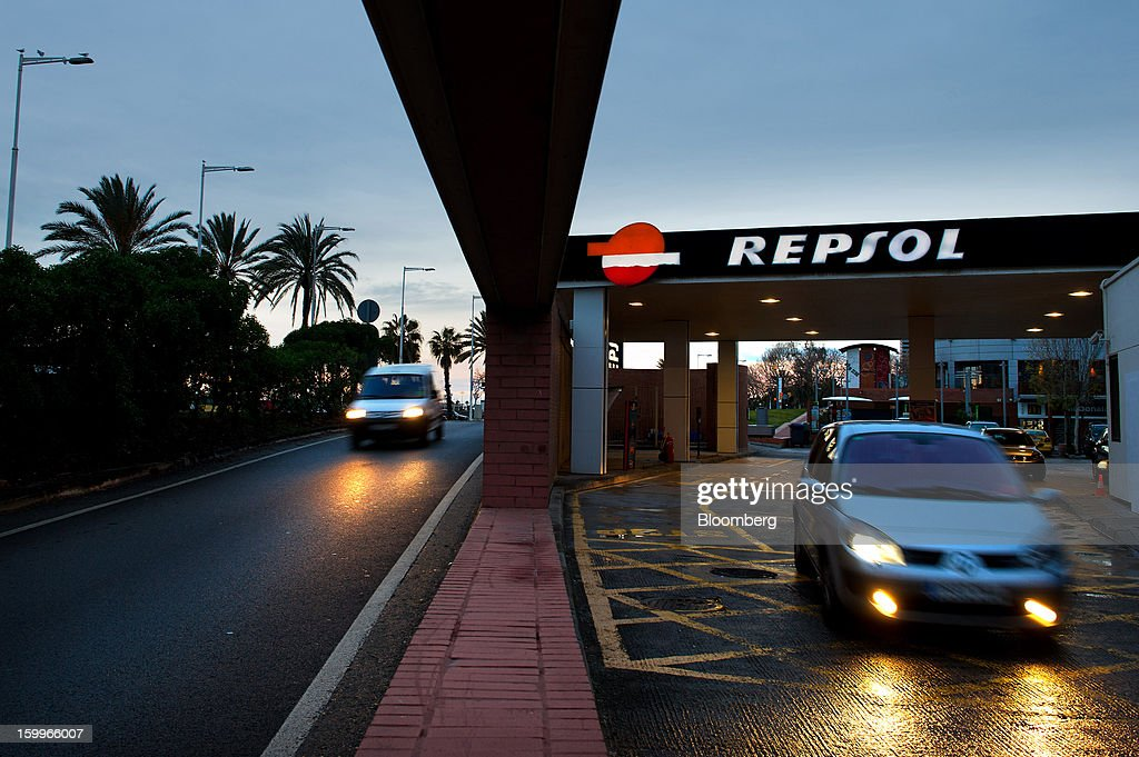 A driver exits a Repsol SA gas station after refuelling near La Marbella beach in Barcelona, Spain, on Wednesday, Jan. 23, 2013. Repsol SA, Spain's largest energy company, expects to sell liquefied natural gas assets for about 2 billion euros ($2.7 billion) by early February, according to a person familiar with the matter. Photographer: David Ramos/Bloomberg via Getty Images