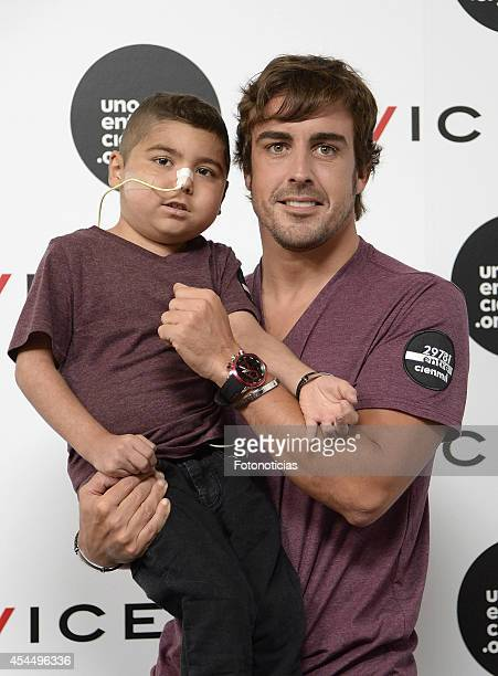 F1 driver Fernando Alonso and 'Uno Entre Cien Mil' foundation present the Viceroy bracelet against childhood leukemia on September 2 2014 in Madrid...