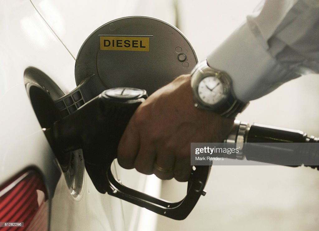 A driver fills up the tank of his car with diesel at a fuel station on May 29 2008 in Luxembourg city Customers are driving up to 100 km from...
