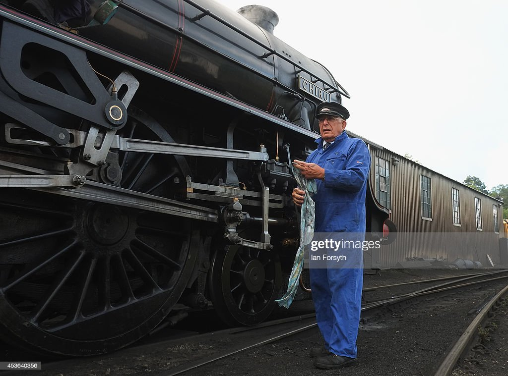 Driver Gerry Skelton makes final preparations on the locomotive 'Chiru' at Grosmont train engine sheds in preparation for the ceremony to mark a second platform opening at Whitby train station on August 15, 2014 in Whitby, England. The second platform will provide passengers with more options for travel to the Yorkshire seaside town on the North Yorkshire Moors Railway and was the first time in half a century two steam locomotives were side by side at the station.