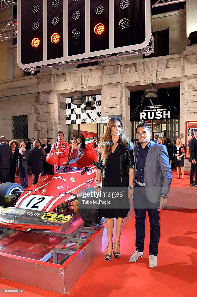 F1 driver <a gi-track='captionPersonalityLinkClicked' href=/galleries/search?phrase=Giancarlo+Fisichella&family=editorial&specificpeople=201672 ng-click='$event.stopPropagation()'>Giancarlo Fisichella</a> and his wife Luna Castellani attend 'Rush' The Movie Rome Premiere at Auditorium della Conciliazione on September 14, 2013 in Rome, Italy.