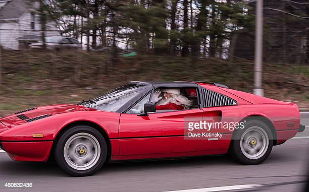 A driver in a red Ferrari dressed as Santa Claus is seen on Christmas Day December 25 on the roads of Wayne NJ