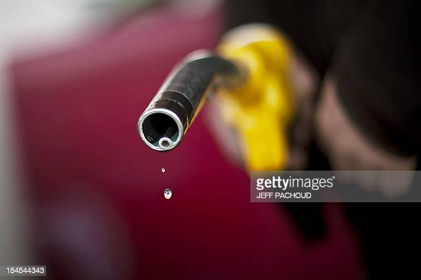A driver is pictured after refueling at a Dijon's gas station on March 9 2011 as petrol prices rose to a record high in France last week with a litre...