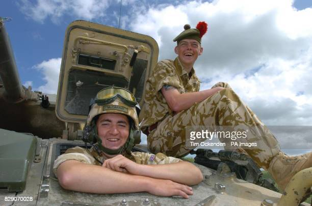 Driver James McCarthy and James Rennie Arbroth members of the 1st Battalion The Black Watch make notes during a training exercise on Salisbury Plain...