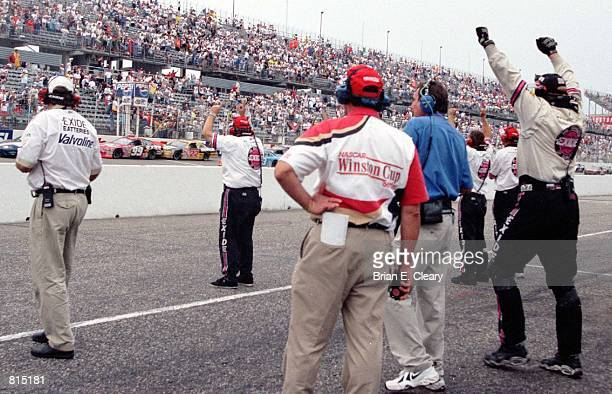 NASCAR driver Jeff Burton's pit crew cheer as he crosses the finish line under caution to win the rain shortened 1999 Southern 500 at Darlington SC...