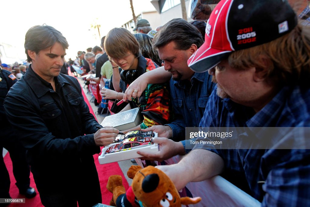 Driver <a gi-track='captionPersonalityLinkClicked' href=/galleries/search?phrase=Jeff+Gordon&family=editorial&specificpeople=171491 ng-click='$event.stopPropagation()'>Jeff Gordon</a>, greets and signs autographs for fans during NASCAR Fanfest presented by Las Vegas Motor Speedway at the Fremont Street Experience on November 28, 2012 in Las Vegas, Nevada.