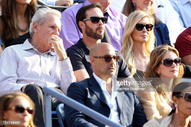 NASCAR driver Jimmie Johnson and his wife Chandra sit behind actor Stanley Tucci as they watch Rafael Nadal of Spain play against Novak Djokovic of...