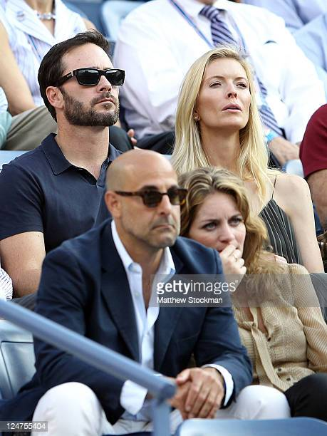 NASCR driver Jimmie Johnson and his wife Chandra watch Rafael Nadal of Spain play against Novak Djokovic of Serbia during the Men's Final on Day...