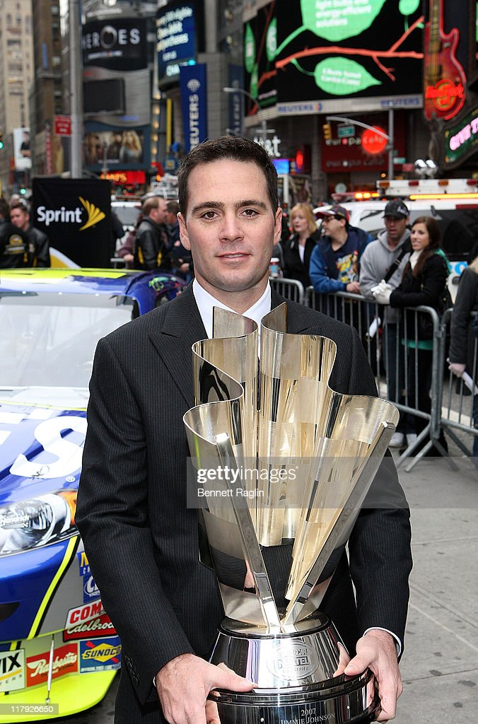 Driver Jimmie Johnson poses for a picture with the NASCAR NEXTEL Cup at the 2007 NASCAR Nextel Cup Series Jimmie Johnson signing in Times Square November 29, 2007 in New York City.