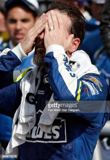 NASCAR driver Jimmie Johnson uses a damp towel to cool down after winning the O'Reilly Auto Parts 500 on Sunday April 9 2017 at Texas Motor Speedway...