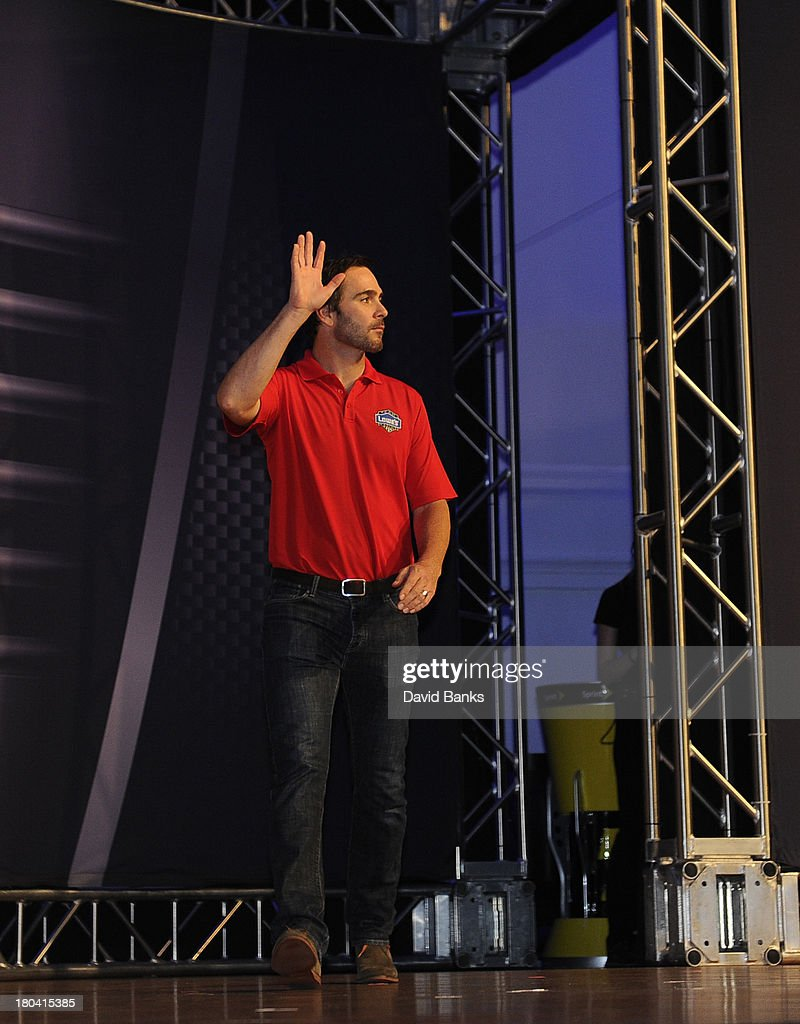 NASCAR driver Jimmy Johnson is introduced during the Chase for the Sprint Cup Contenders Live on September 12, 2013 in Chicago, Illinois.