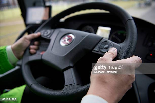 A driver keeps his hands on the steering wheel in a coach of german coach company Flixbus Mein Fernbus on January 09 2015 in Berlin Germany The coach...