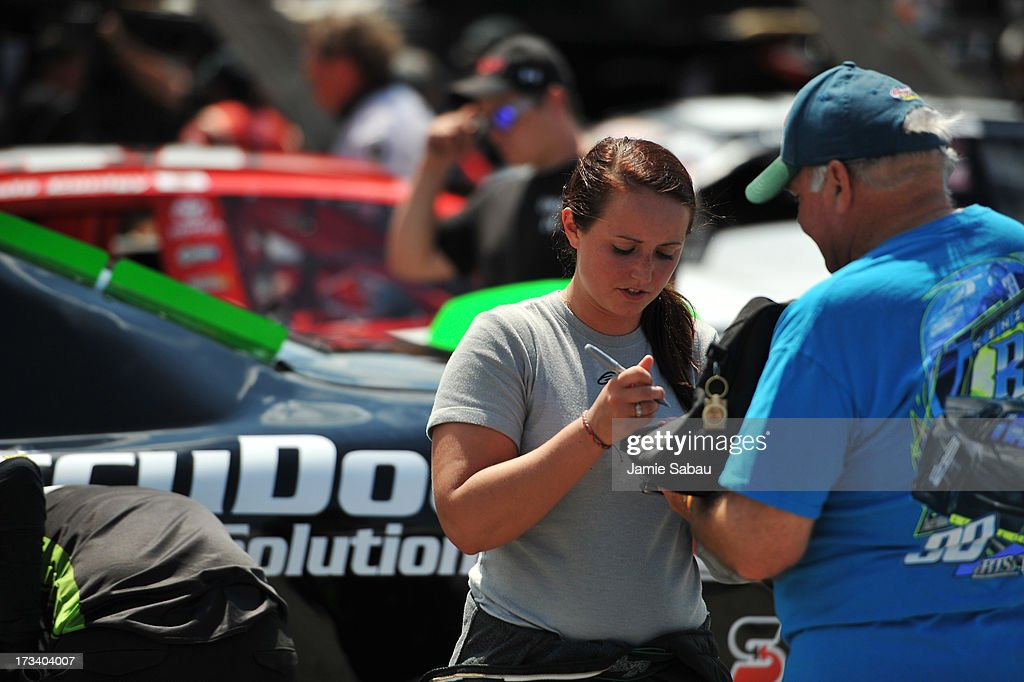 Driver Kenzie Ruston signs an autograph after her practice session for the NASCAR K&N Pro Series, East NAPA 150 on July 13, 2013 at Columbus Motor Speedway in Columbus, Ohio.