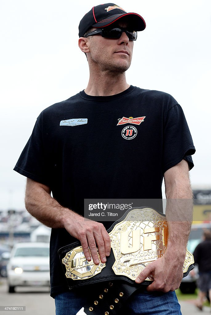 NASCAR driver <a gi-track='captionPersonalityLinkClicked' href=/galleries/search?phrase=Kevin+Harvick&family=editorial&specificpeople=209186 ng-click='$event.stopPropagation()'>Kevin Harvick</a> holds an UFC belt presented to him by Donald 'Cowboy' Cerrone (not pictured) at Daytona International Speedway on February 22, 2014 in Daytona Beach, Florida.