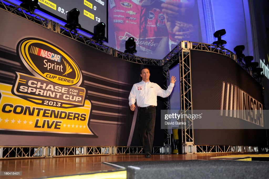 NASCAR driver <a gi-track='captionPersonalityLinkClicked' href=/galleries/search?phrase=Kevin+Harvick&family=editorial&specificpeople=209186 ng-click='$event.stopPropagation()'>Kevin Harvick</a> is introduced during the Chase for the Sprint Cup Contenders Live on September 12, 2013 in Chicago, Illinois.