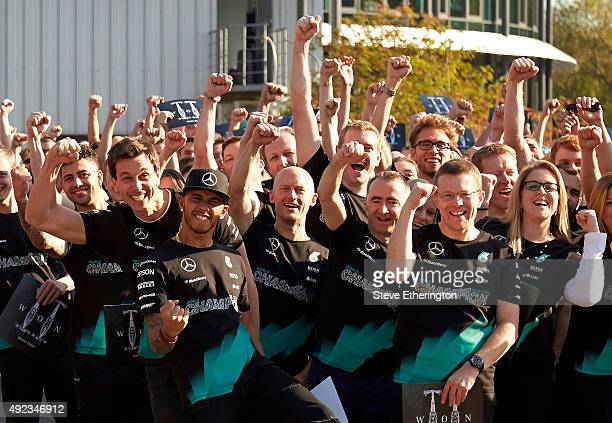 Driver Lewis Hamilton celebrates with Head of MercedesBenz Motorsport Toto Wolff Managing Director Mercedes AMG High Performance Powertrains Andy...