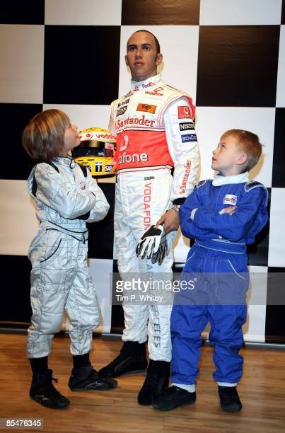 Driver Lewis Hamilton has his waxwork unveiled at Madame Tussauds and appears with F1 champs of the future Billy Monger and Myles Apps on March 18...