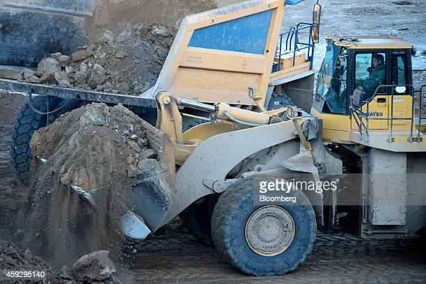 A driver lifts a bucket of oil shale into a dumper truck in the open pit at Eesti Energia AS's mine in Narva Estonia on Wednesday Nov 19 2014 Eesti...