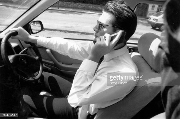 A driver making a call on his mobile phone 1996