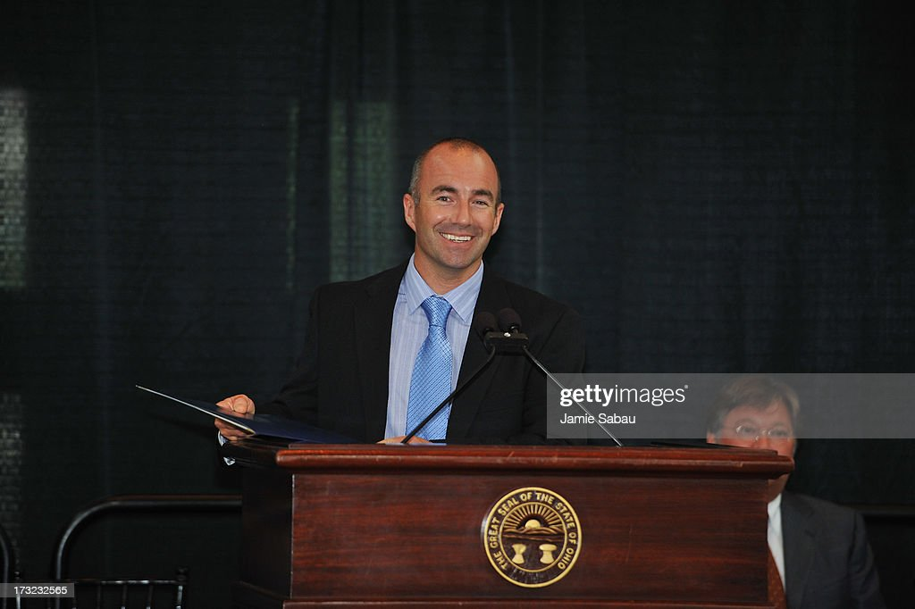 NASCAR driver <a gi-track='captionPersonalityLinkClicked' href=/galleries/search?phrase=Marcos+Ambrose&family=editorial&specificpeople=179434 ng-click='$event.stopPropagation()'>Marcos Ambrose</a> accepts a commendation given by Ohio State Representative Barbara Sears at the Ohio Statehouse on July 10, 2013 in Columbus, Ohio.