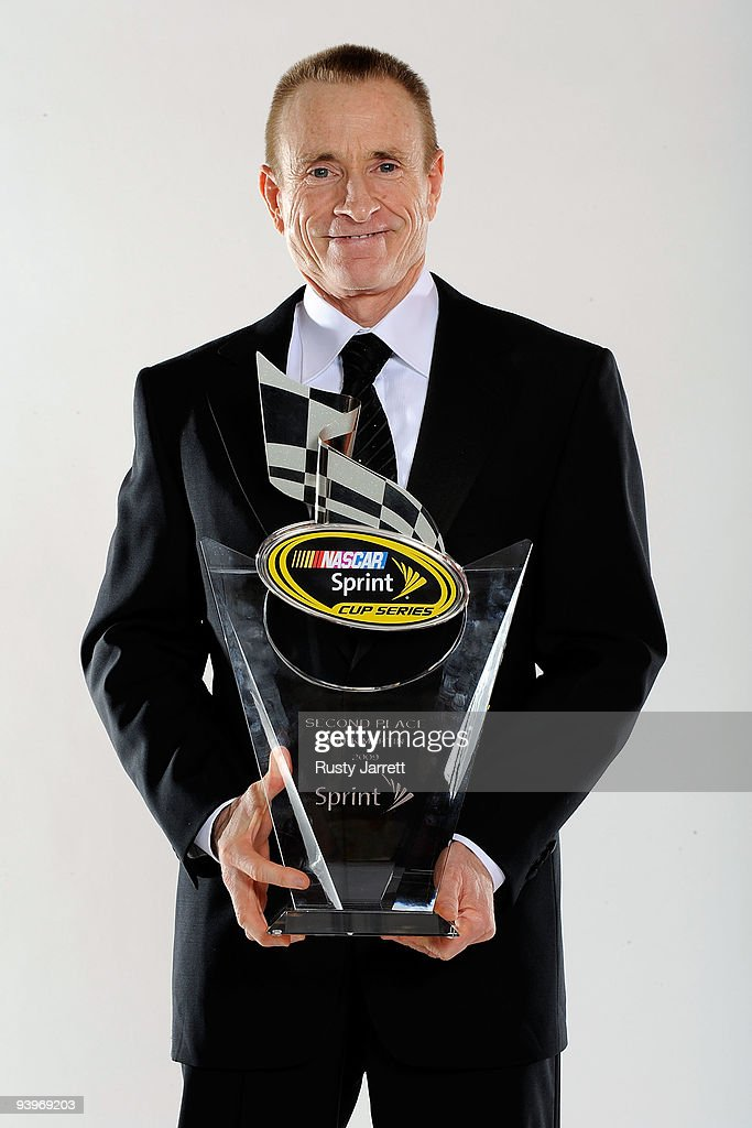 Driver <a gi-track='captionPersonalityLinkClicked' href=/galleries/search?phrase=Mark+Martin&family=editorial&specificpeople=204455 ng-click='$event.stopPropagation()'>Mark Martin</a> poses with the 2nd place award during the NASCAR Sprint Cup Series awards banquet during the final day of the NASCAR Sprint Cup Series Champions Week on December 4, 2009 in Las Vegas, Nevada.