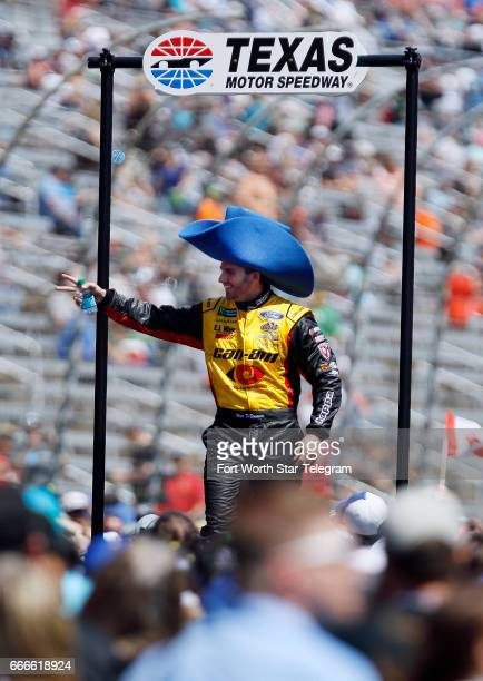 NASCAR driver Matt DiBenedetto waves to fans before the start of the O'Reilly Auto Parts 500 on Sunday April 9 2017 at Texas Motor Speedway in Fort...