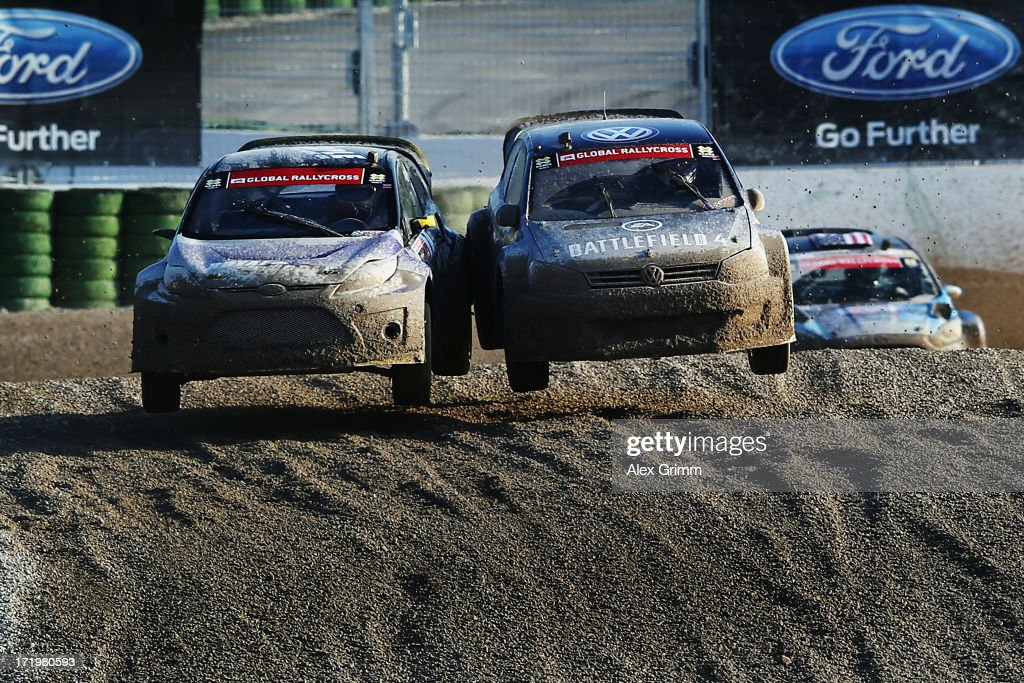 DTM driver <a gi-track='captionPersonalityLinkClicked' href=/galleries/search?phrase=Mattias+Ekstroem&family=editorial&specificpeople=625135 ng-click='$event.stopPropagation()'>Mattias Ekstroem</a> (R) of Sweden competes with <a gi-track='captionPersonalityLinkClicked' href=/galleries/search?phrase=Townsend+Bell&family=editorial&specificpeople=226820 ng-click='$event.stopPropagation()'>Townsend Bell</a> of the United States in the Ford RallyCross competition on Day 4 of the X-Games at FroettmaRing on June 30, 2013 in Munich, Germany.