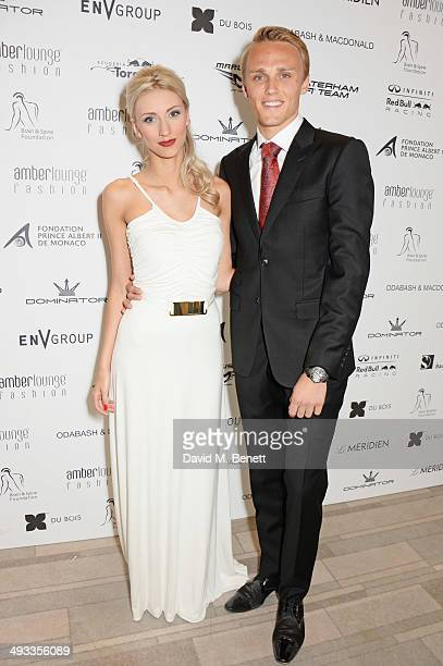 Driver Max Chilton and Chloe Roberts attend the Amber Lounge 2014 Gala at Le Meridien Beach Plaza Hotel on May 23 2014 in Monaco Monaco