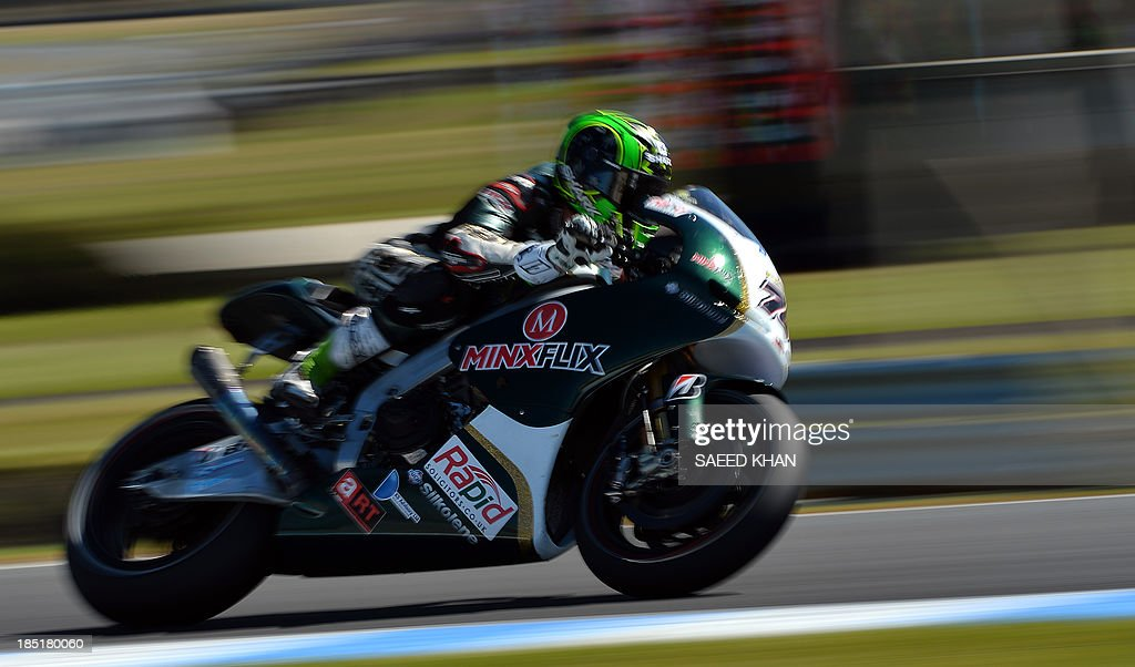 PBM driver Michael Laverty of Great Britain powers his bike during the second practice session of the Australian MotoGP Grand Prix at Phillip Island on October 18, 2013. AFP PHOTO/ Saeed KHAN USE