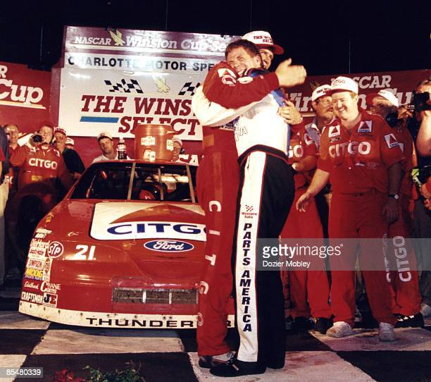 Driver Michael Waltrip gets a big hug from brother Darrell Waltrip after winning the 1996 The Winston Select race on May 20 1996 at the Charlotte...