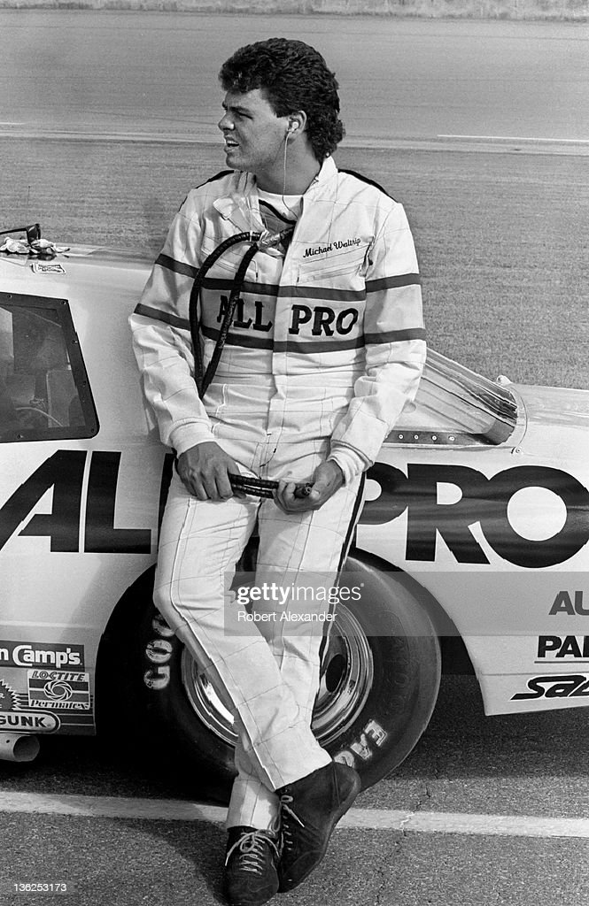 NASCAR driver Michael Waltrip stands beside his race car prior to the start of the 1987 Firecracker 400 on July 4 1987 at the Daytona International...