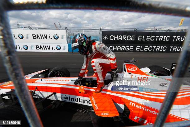 Driver Nick Heidfeld of Machindra Racing gets out of his car off after it broke an axle during the Formula E Qualcomm New York City ePrix on July 15...