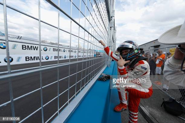 Driver Nick Heidfeld of Machindra Racing looks on after his car broke an axle during the Formula E Qualcomm New York City ePrix on July 15 2017 in...