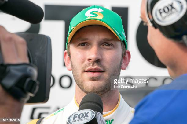 Driver of the Subway Car Daniel Suarez stops to answer questions for a reporter during qualifying for the Auto Club 400 NASCAR Monster Energy Cup...