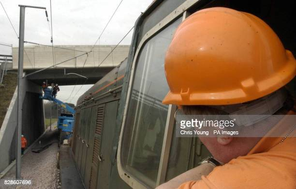 A driver on a works train looks back as technicians working on the new Channel Tunnel Rail Link near Sandling Kent make final checks on the 25000...