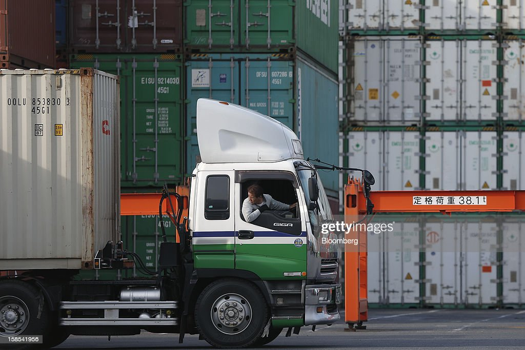 A driver parks a container truck at a container terminal in Tokyo, Japan, on Tuesday, Dec. 18, 2012. Japan's exports fell for a sixth month in November and the trade deficit swelled, underscoring the challenge that incoming Prime Minister Shinzo Abe faces in reviving growth. Photographer: Kiyoshi Ota/Bloomberg via Getty Images