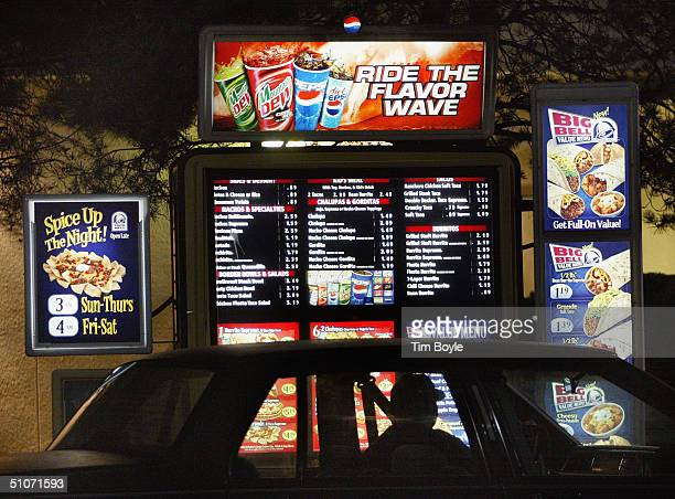A driver places a driveup order at a Taco Bell fastfood restaurant July 15 2004 in Mount Prospect Illinois Fastfood restaurant chains are stepping up...