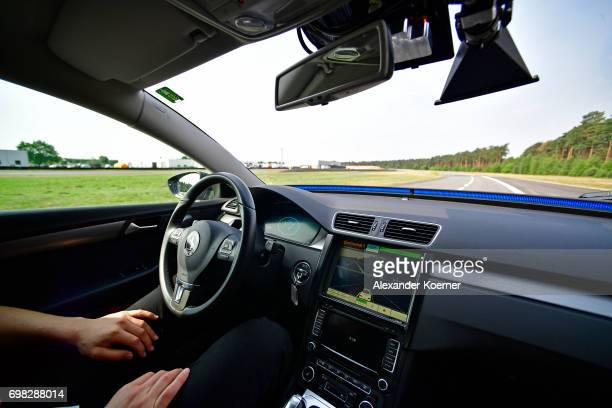 A driver presents a Cruising Chauffeur a hands free selfdriving system designed for motorways during a media event by Continental to showcase new...