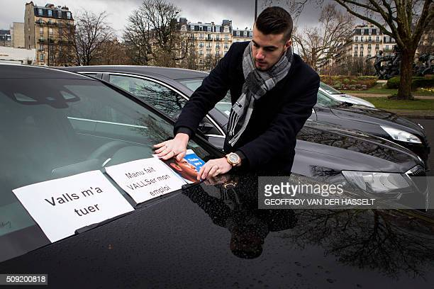 A VTC driver puts a sign on his windshield that reads 'Valls wants to kill me' refering to French Prime Minister Manuel Valls as VTC vehicles block...
