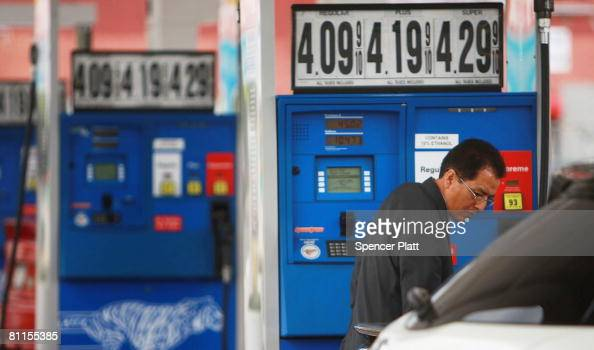 A driver puts fuel in his car at a gas station where prices have gone over $4 per gallon May 19 2008 in Douglaston in the borough of Queens New York...