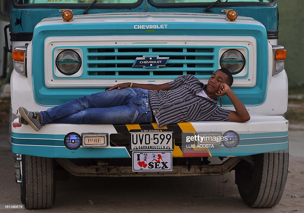A driver rests as he waits for dancers during the third day of carnival in Barranquilla, Colombia, on February 11, 2013. Barranquilla's Carnival, a tradition created by locals at the end of the 19th century as a response and to parody the celebration held by European immigrants and aristocracy, was declared a 'Masterpiece of Oral and Intangible Heritage of Humanity' by the UNESCO in 2003. AFP PHOTO/Luis Acosta